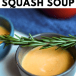 Blue bowl of Creamy butternut squash soup with a branch rosemary on top