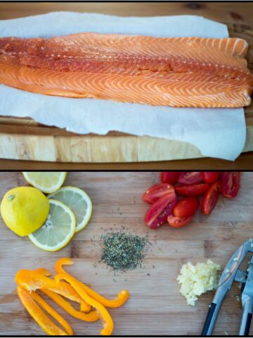 Salmon on cutting board with toppings