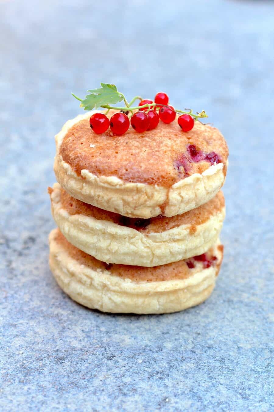 Stack of red currants and almonds mini pies
