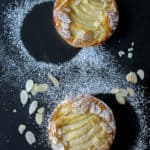View from above of French tart Amandine: a delicious flaky crust with an almond cream filling and a juicy pear.