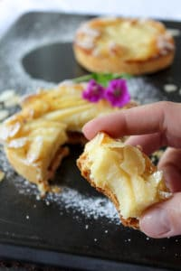 Bite in French tart Amandine: a delicious flaky crust with an almond cream filling and a juicy pear. #french #baking #almond #frenchbaking #dessert