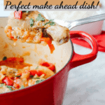 Easy and Delicious drumstick Basque Chicken on a spoon with a partial view of iron cast pot