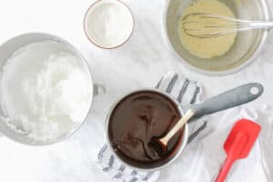 Mise en place of ingredients: eggs, sugar, chocolate & butter melted, flour, whisk