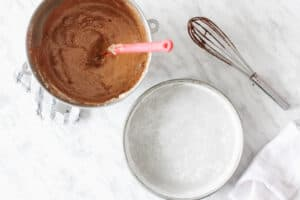Batter and mold buttered and floured. Whisk with chocolate.