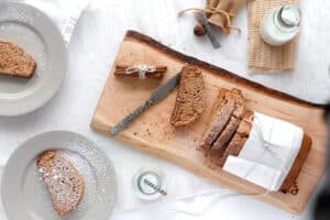Above view of a sliced spice cake on a wooden board