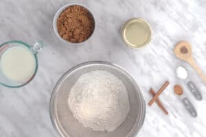 Bowl with flour and dry ingredients around it