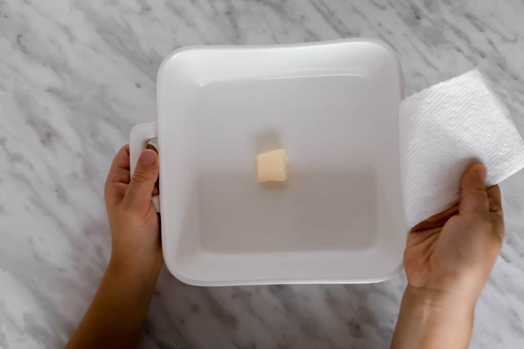 Piece of butter in a square white oven dish