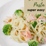 Close up of salmon and broccoli pasta in a white plate