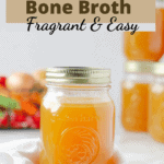 Close up of a Mason jar with broth in it and a few jars in the background