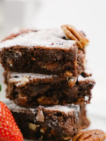 Close up to a stack of gooey chocolate condensed milk brownies