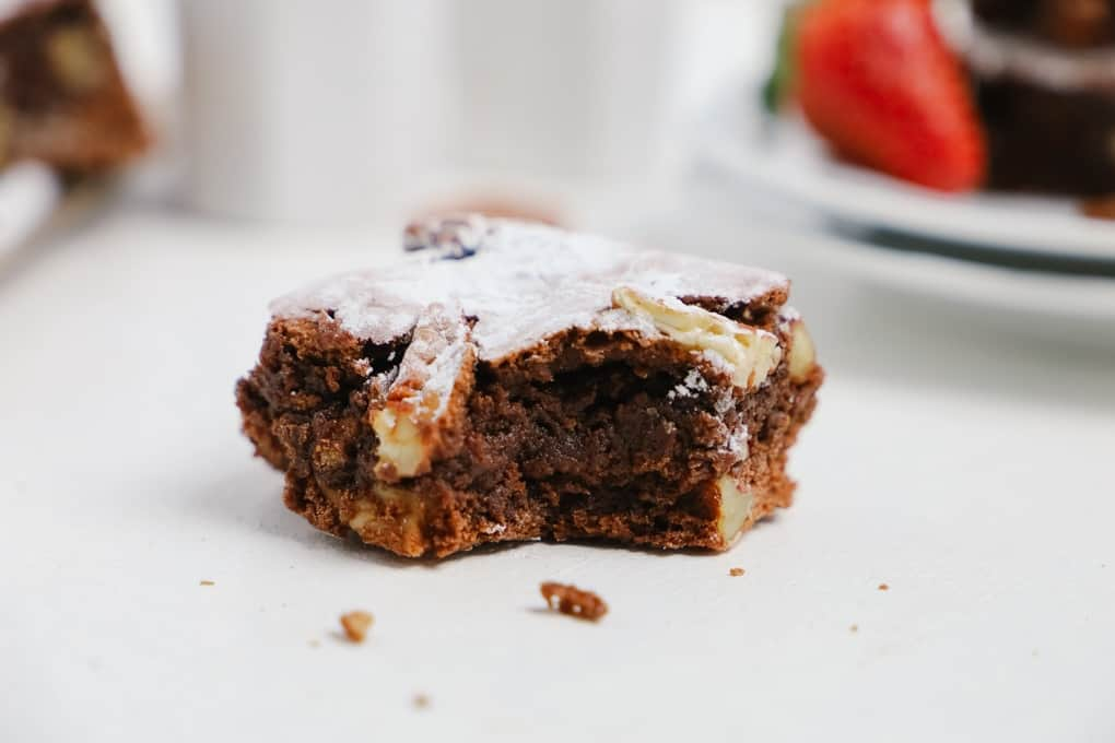 Close up of a bitten chocolate brownie square