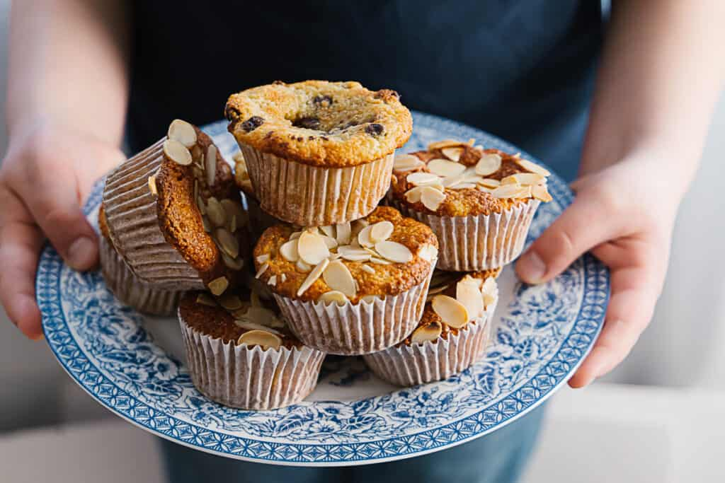 Side view of a blue plate filled with almond flour banana muffins