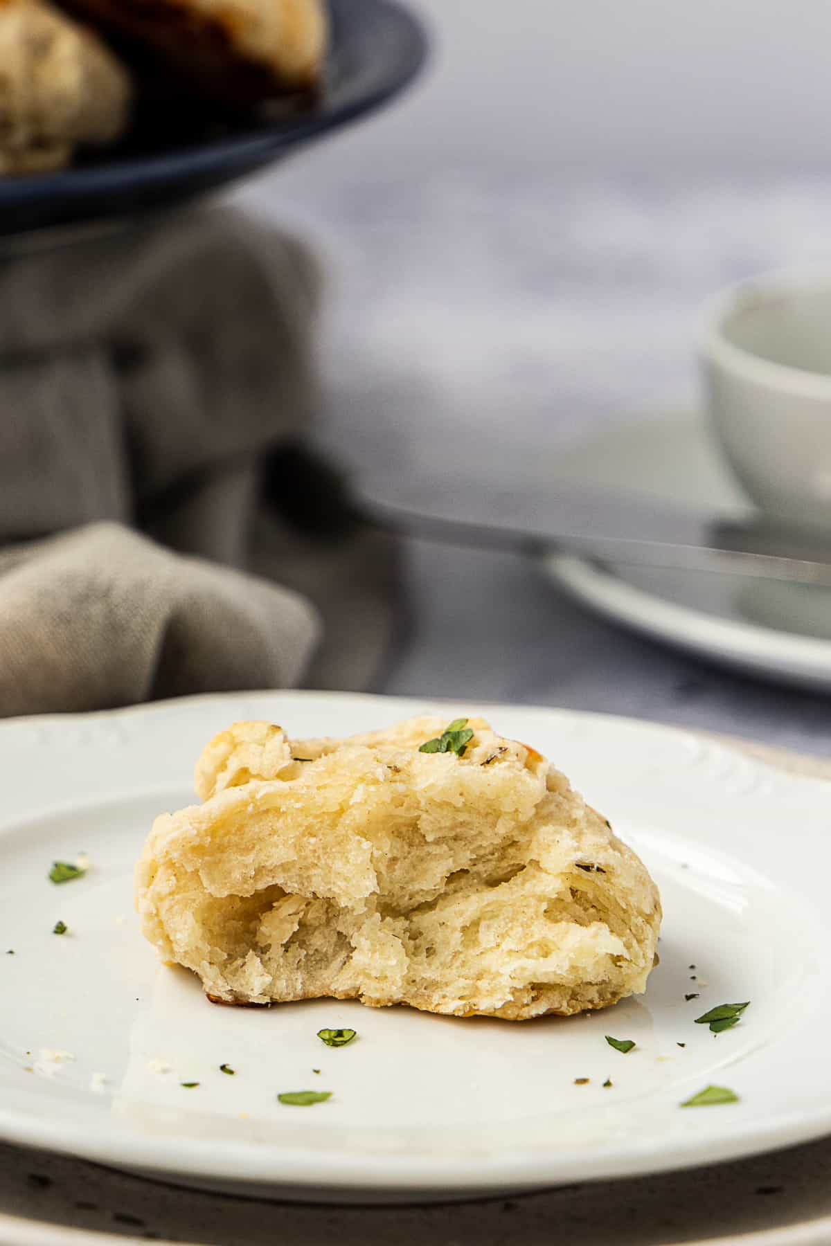 Close up of half a cheese biscuit on a white plate