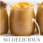 3 glass jars lined up with dulce de leche mousse in it. The middle one has a spoon in it and the 2 other ones have some shaved chocolate on it.