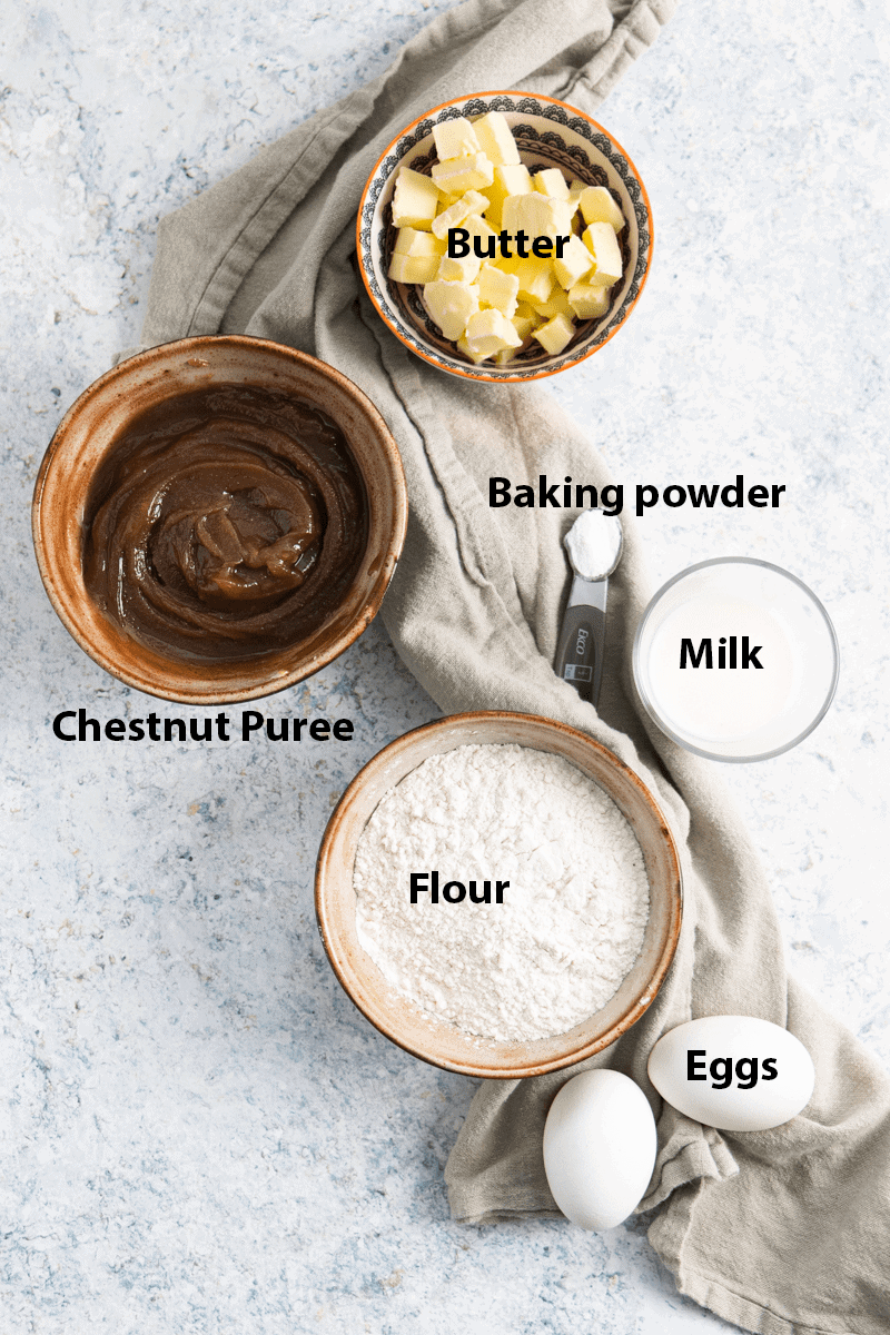 top view of the ingredients: chestnut puree, flour, eggs, milk, butter and baking powder. All labelled.